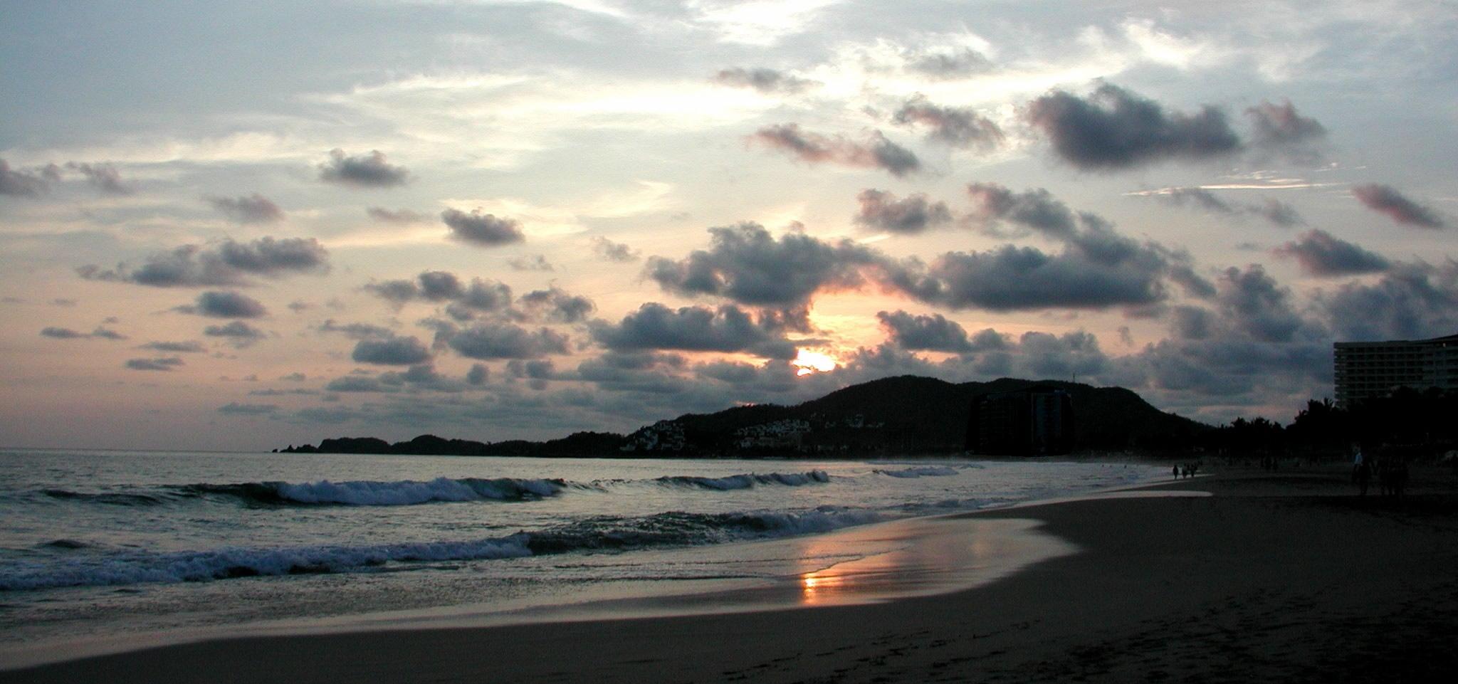 sunset on beach at ixtapa mexico