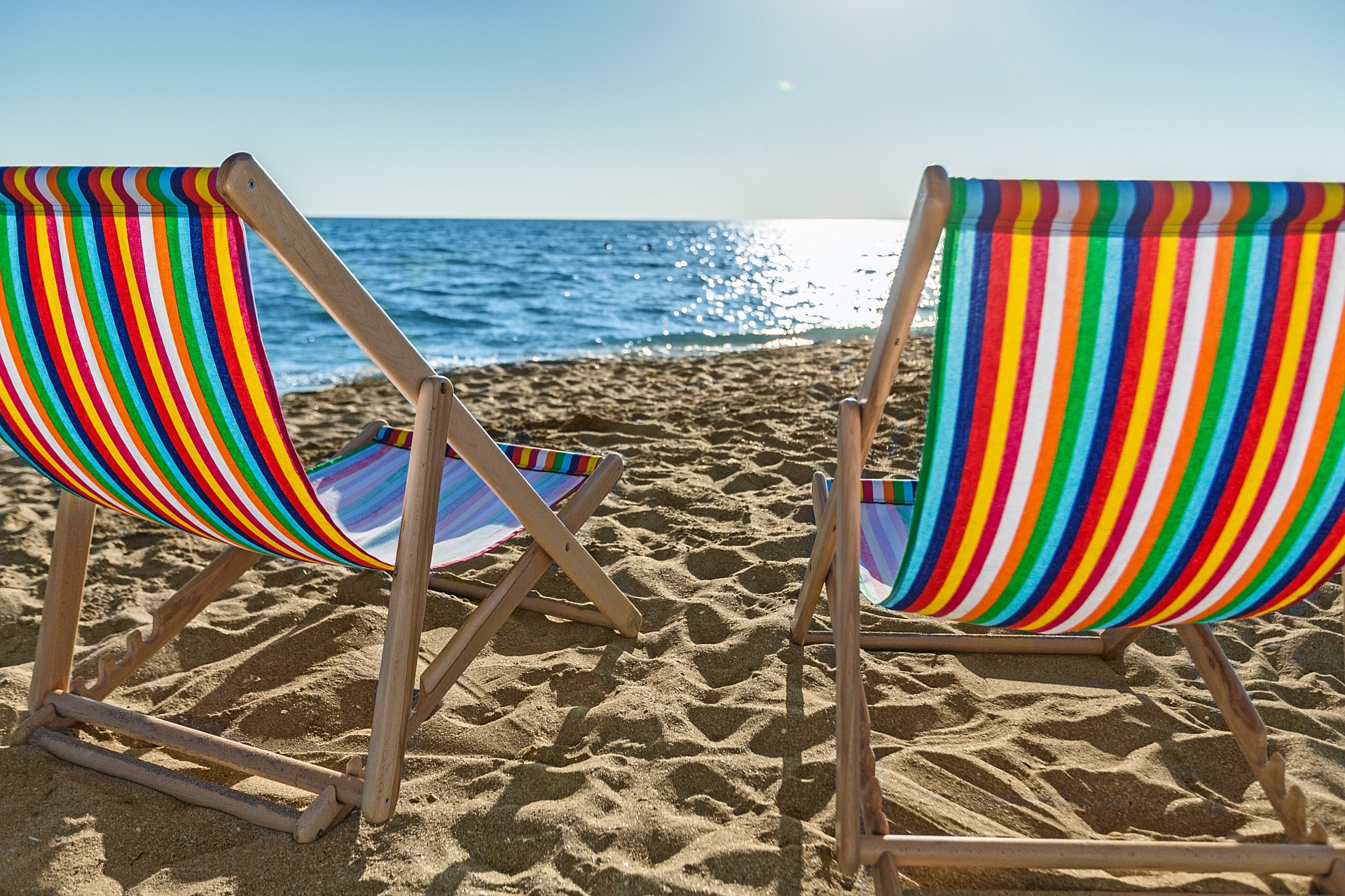 lounge chairs on beach in mexico