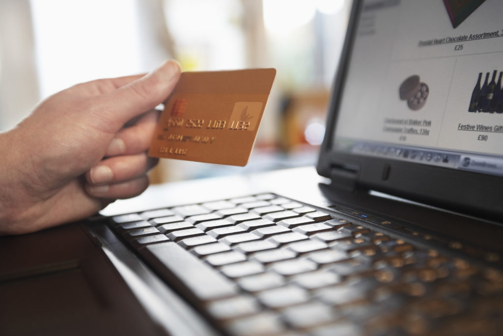 shopping online with credit card and computer